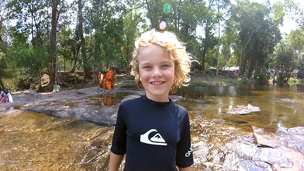 Siem Reap with Kids: Paddling with monks in the river at Phnom Kulen