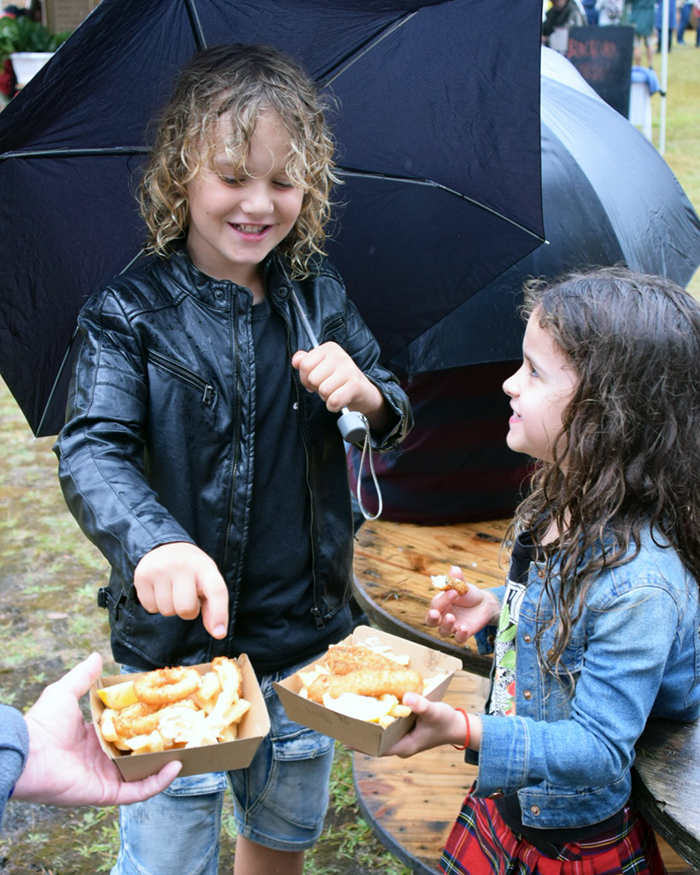 Even the rain cant dampen our enthusiasm for eating at the Koonya Garlic Festival