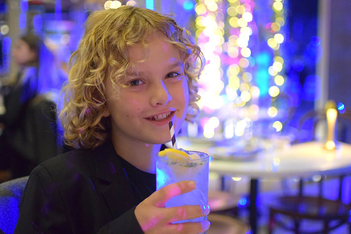 Raff drinking from a paper straw at Love Fish Barangaroo who have banned plastic straws.