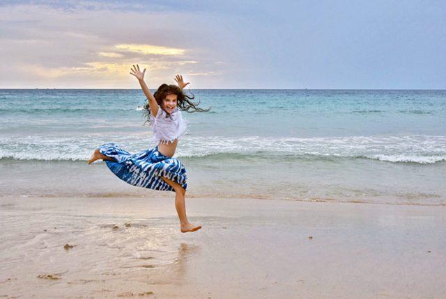 happy young girl on Surin Beach phuket