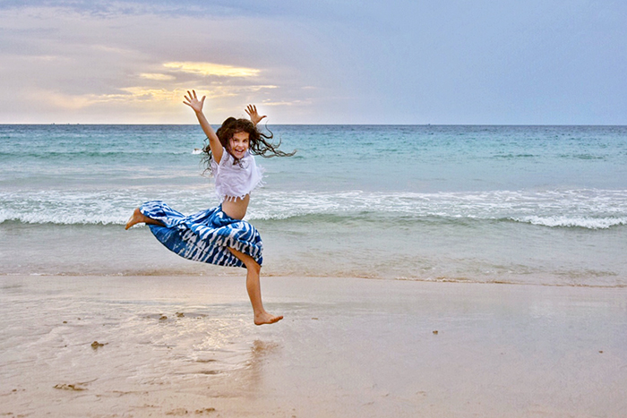 happy young girl on Surin Beach phuket