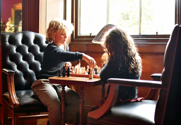 Kids playing chess at Dalhousie Castle
