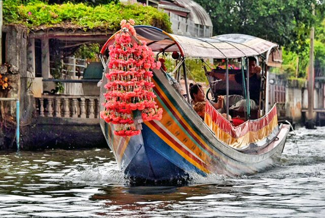 Take a longboat tour through Bangkok's Klongs