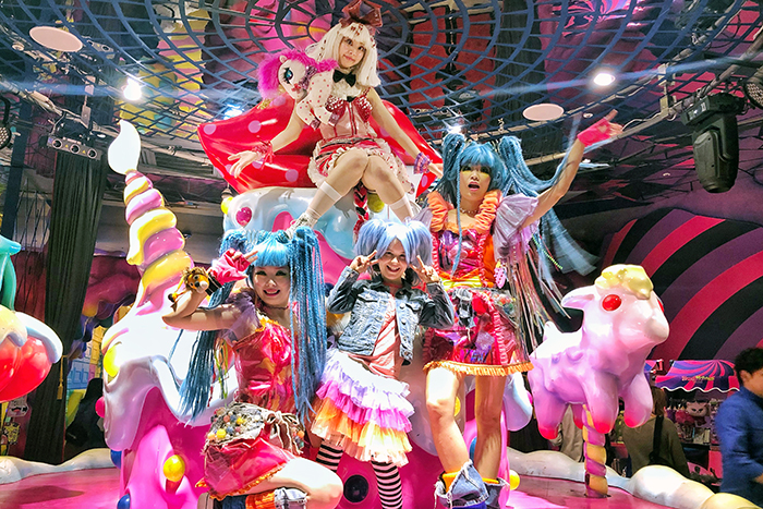 Kawaii Monster Cafe performers with a kid