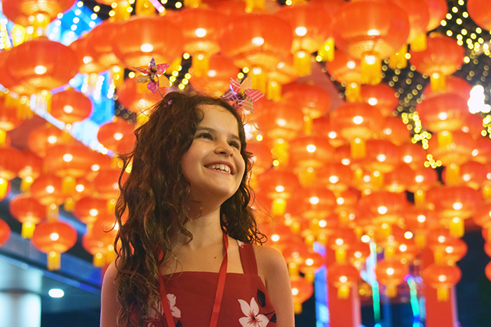 curly haired little girl celebrating Chinese New Year in Guangzhou