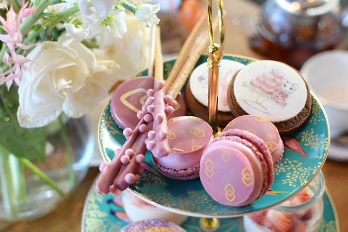 pretty in pink - petit fours on a green plate