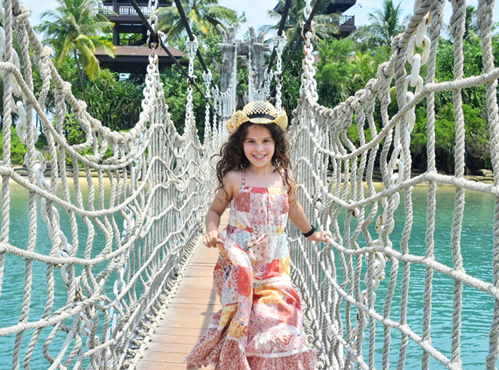 Little girl on a rope bridge at Palawan Beach Sentosa