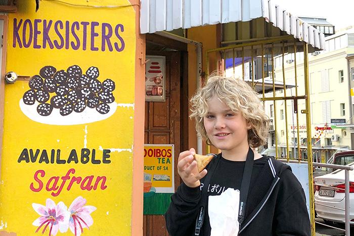 child eating koeksister and samoosa for breakfast at Rose Corner Café Bo Kaap