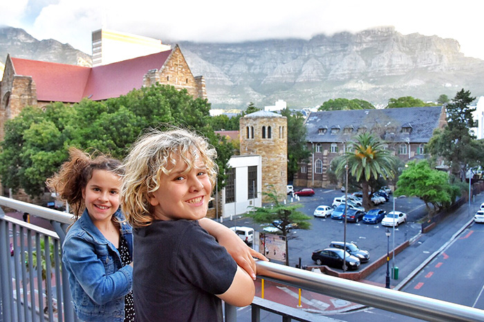 Two kids enjoying the view from Mandela Rhodes Place Hotel