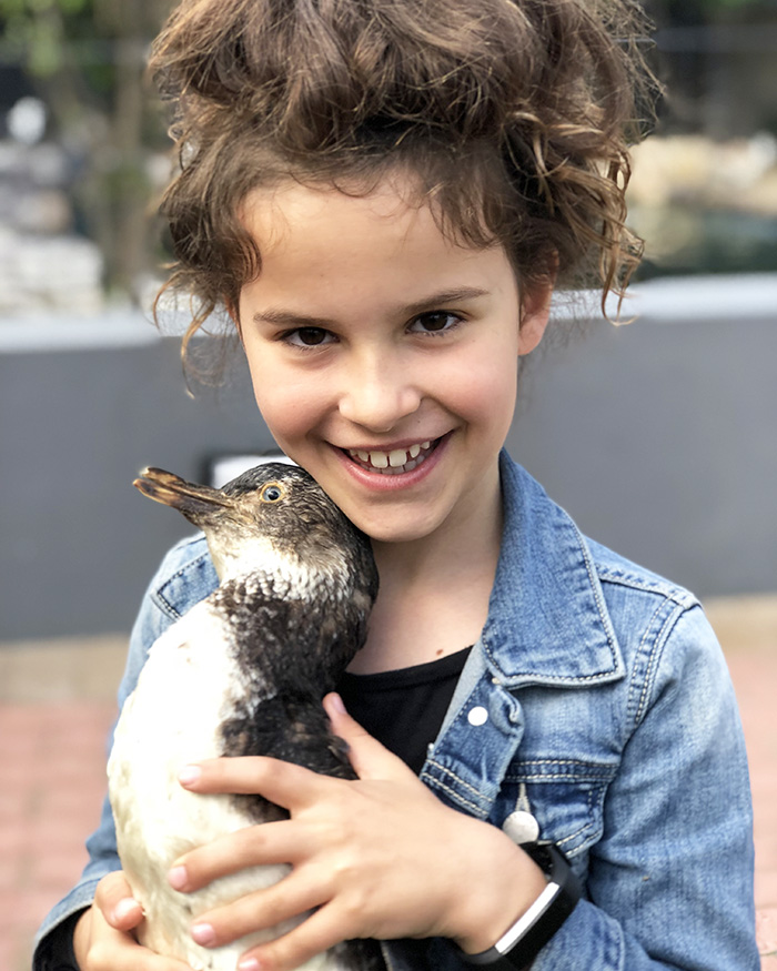 Little kid with a taxidermy penguin pal at SANCCOB