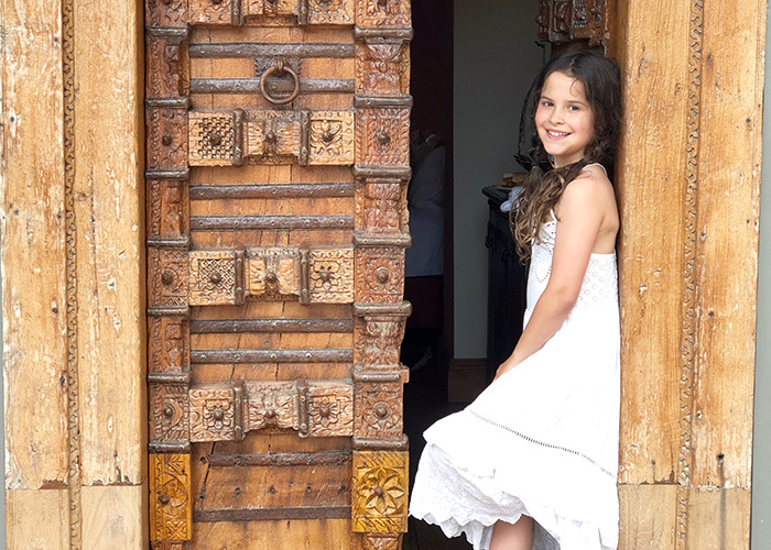 Little girl in the doorway of the Lamu Suite at Tintswalo Atlantic