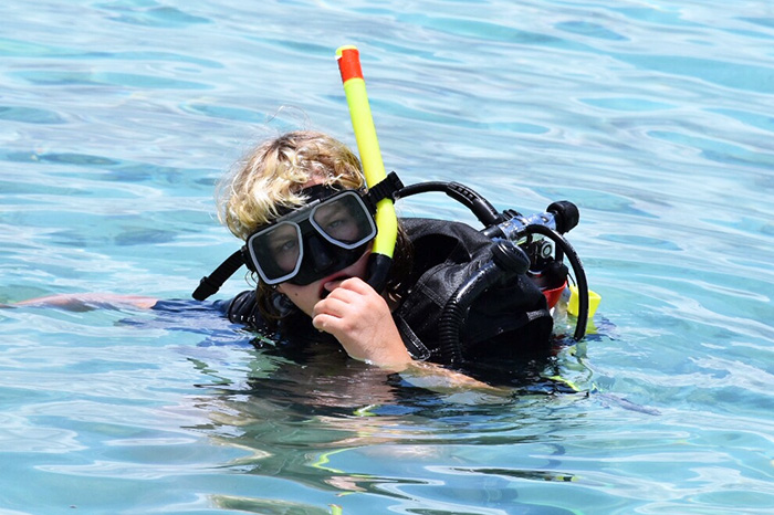 Baby diver at Tivua Island