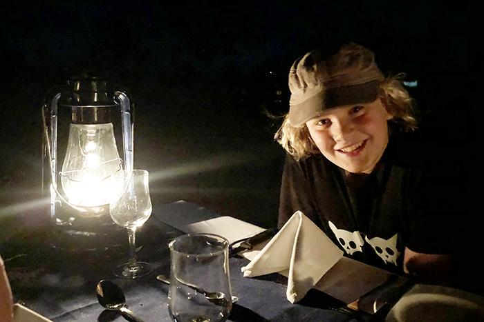 Dining by lantern light at Sabi Sabi Bush lodge