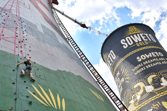 Boy climbing Soweto Towers in Johannesburg
