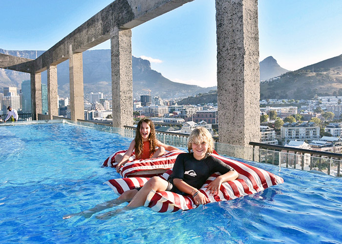 The extraordinary rooftop pool at the Silo Cape Town is pne of the most beautiful on earth with views over Table Mountain, Signal Hill and the ocean