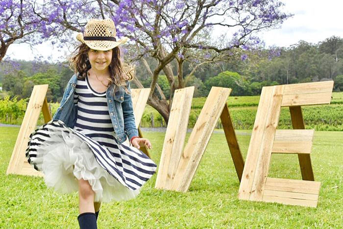 sassy young girl at at Bago Vineyard and Maze