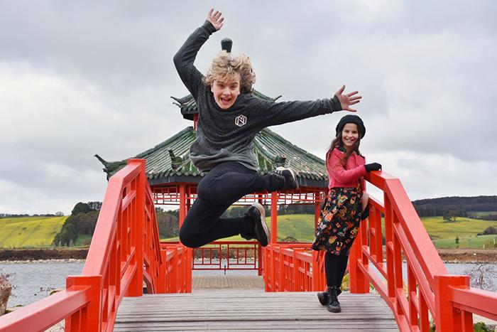 Kids leapin off bridge at Mayfield garden