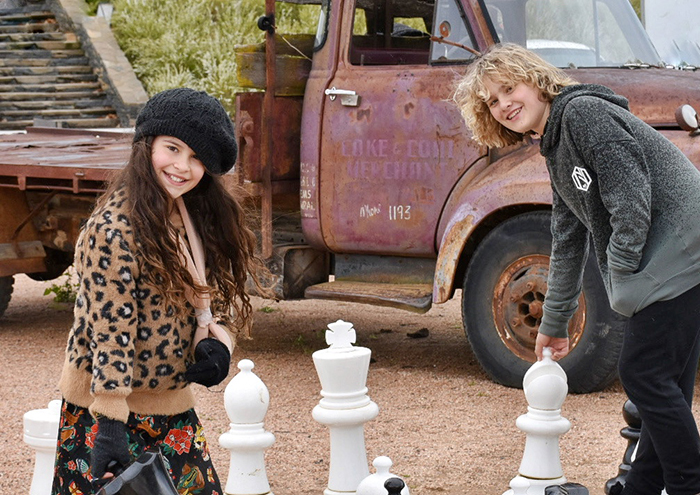 Kids playing giant chess at Mayfield Garden Oberon