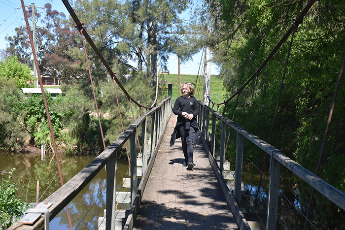 Boy crossing Canowindra's Swinging Bridge with Blind Freddy's Bushranger Tours© Aleney de WInter/BoyEatsWorld