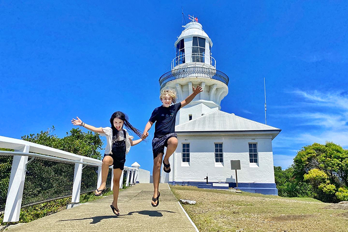 Leaping into Smoky Cape Lighthouse with kids © Aleney de WInter/BoyEatsWorld