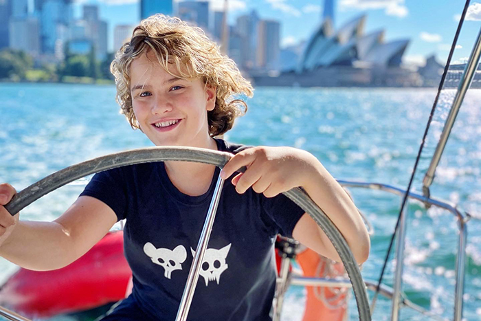 Boy Learning to sail on a Sydney by Sail B&B