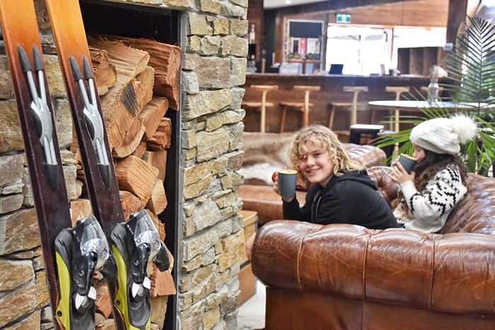 Hot chocolates by the fire at Vertikal Indoor Snowsports ©Aleney de Winter