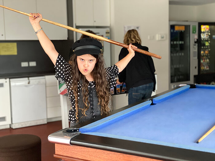 Playing pool in the games room at Sydney Harbour YHA