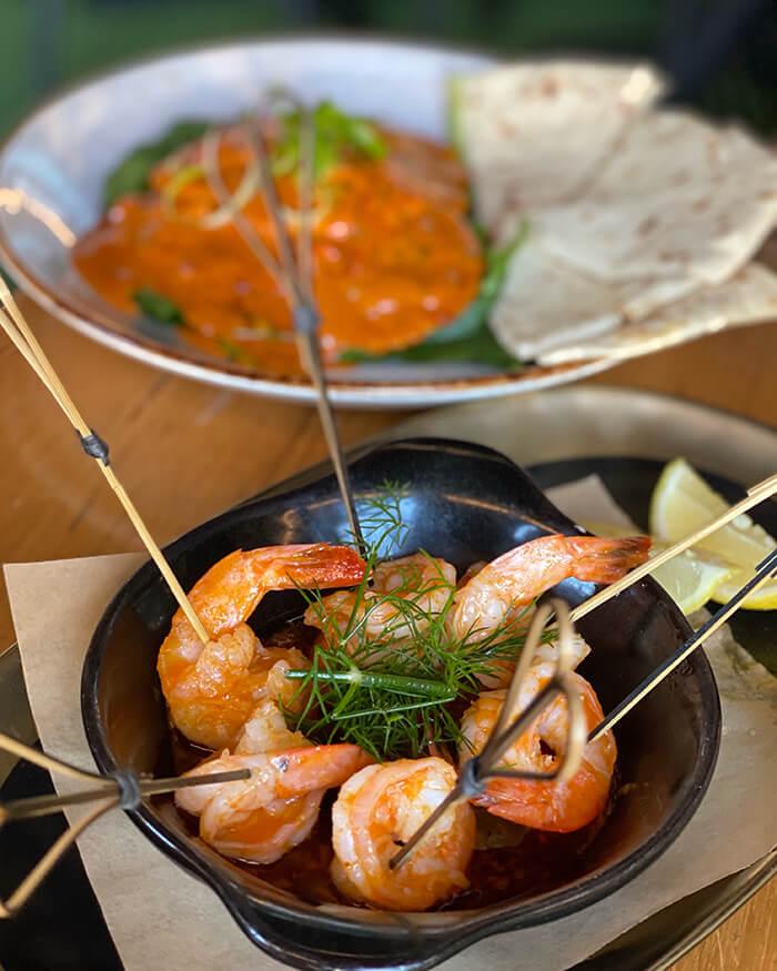 Duck ravioli and prawn lollipops at Planar Restaurant Darling Harbour
