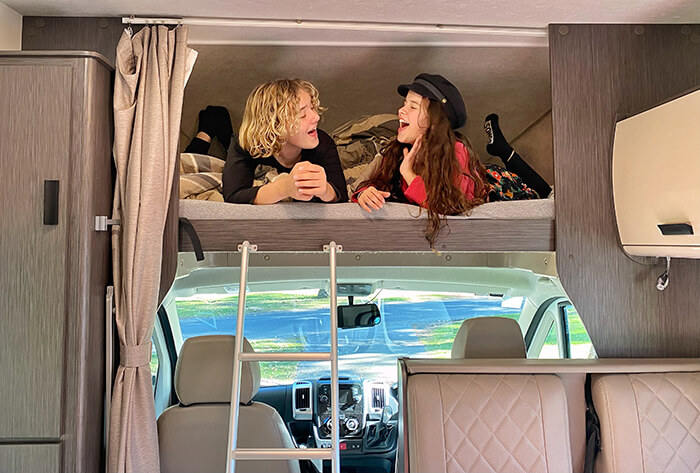 Kids in the overhead bed in a 6-berth motorhome